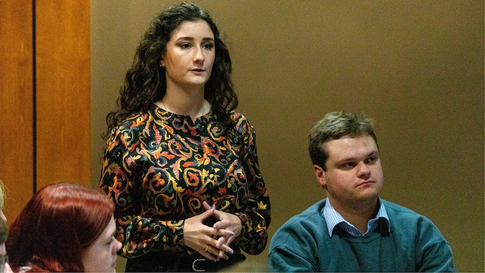 Student Government Association senator Gina Esposito, author of the new resolution on excused absences, speaks to the senate Nov. 13, 2019. The resolution calls on Ball State's administration to change its policy on excused absences for students participating in university-related events and programs. John Lynch, DN