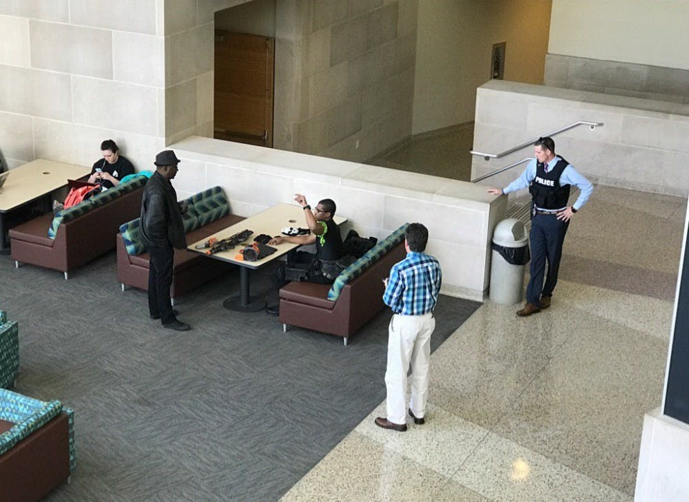 <p>University police officers speak with a man who had a Nerf gun during the shelter in place alert on campus. <em>Tim Underhill //&nbsp;</em><em>Photo provided</em></p>