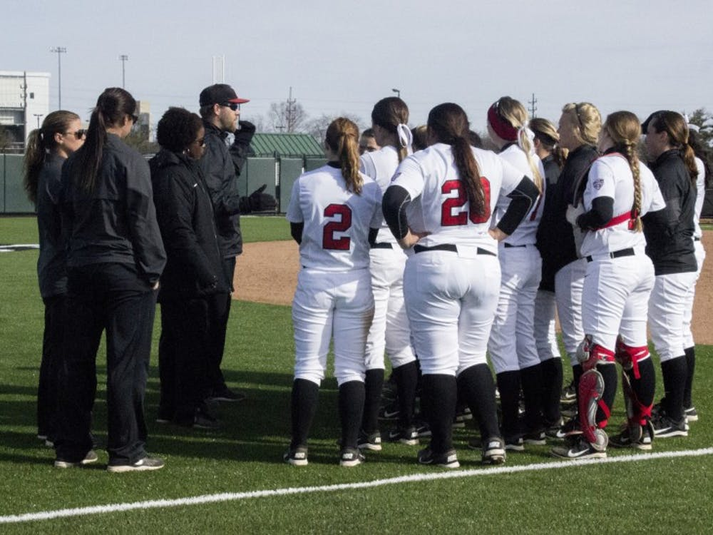 The Cardinals meet up with their coaches after their first win  against IPFW March 18 at the Softball Field at the First Merchants Ballpark Complex.  DN PHOTO MAKAYLA JOHNSON