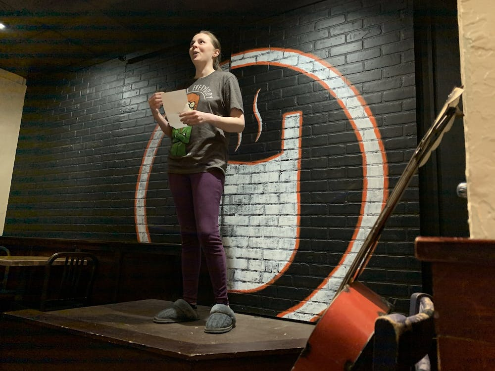 <p>Amanda Loper finishes reading her poem on sugar cream pie Jan. 26, 2020, at The Cup. Cuplets at The Cup is a scheduled monthly event in Muncie currently hosted on Facebook during the COVID-19 pandemic. <strong>Taylor Smith, DN File</strong></p>