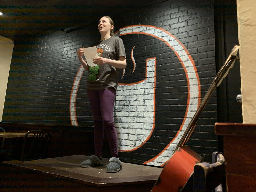 Amanda Loper finishes reading her poem on sugar cream pie Jan. 26, 2020, at The Cup. Cuplets at The Cup is a scheduled monthly event in Muncie currently hosted on Facebook during the COVID-19 pandemic. Taylor Smith, DN File