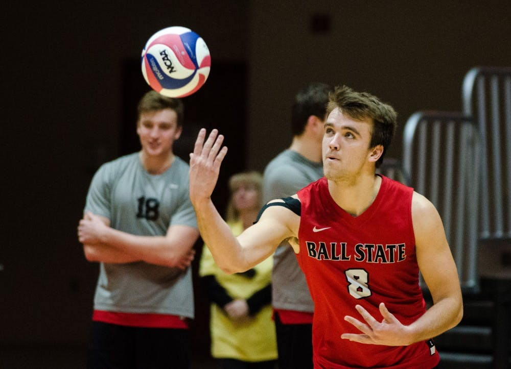 <p>Sophomore outside attacker Blake Reardon serves the ball to Lewis University during a match on Feb. 16 in John E. Worthen Arena. <strong>Madeline Grosh, DN</strong></p>