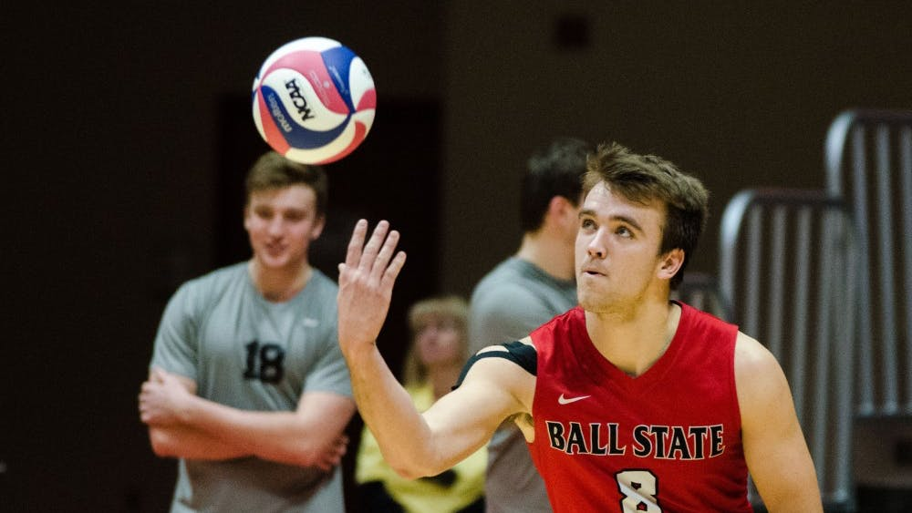 Sophomore outside attacker Blake Reardon serves the ball to Lewis University during a match on Feb. 16 in John E. Worthen Arena. Madeline Grosh, DN