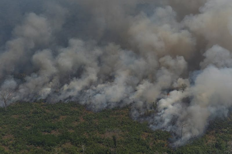 Wildfires consume an area near Porto Velho, Brazil, Friday, Aug. 23, 2019. Brazilian state experts have reported a record of nearly 77,000 wildfires across the country so far this year, up 85% over the same period in 2018. Brazil contains about 60% of the Amazon rainforest, whose degradation could have severe consequences for global climate and rainfall. (AP Photo/Victor R. Caivano)