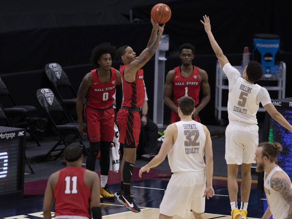 Cardinals senior guard Ishmael El-Amin shoots a three pointer during the second half of the quarterfinals game of the Mid American Conference Tournament against the Toledo Rockets March 11, 2021, at Rocket Mortgage Fieldhouse in Cleveland, Ohio. The Cardinals lose to the Rockets 91-89 in overtime. Jacob Musselman, DN