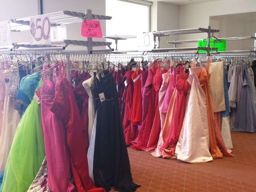 Donated prom dresses hang next to each other at Ball State's Fashion Merchandising Association's annual event, Cinderella's Closet. High schools students can purchase donated dresses for affordable prices. DN PHOTO TRISTAN BENNINGTON