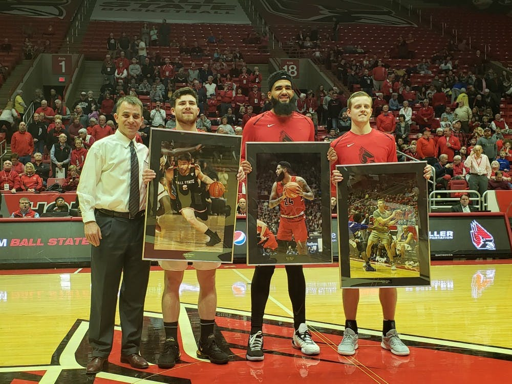 Ball State Men's Basketball head coach James Whitford stands with seniors Tayler Persons, Trey Moses and Austin Nehls March 8, 2019, in Worthen Arena. The seniors were honored for senior night. Zach Piatt, DN
