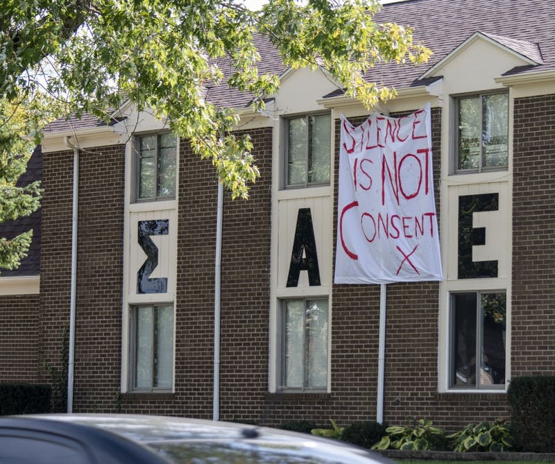 Ball State's Sigma Alpha Epsilon chapter hangs a bed sheet outside its house. Ball State fraternities hung bedsheets with messages of consent in front of their houses Oct. 15, 2018. Stephanie Amador, DN