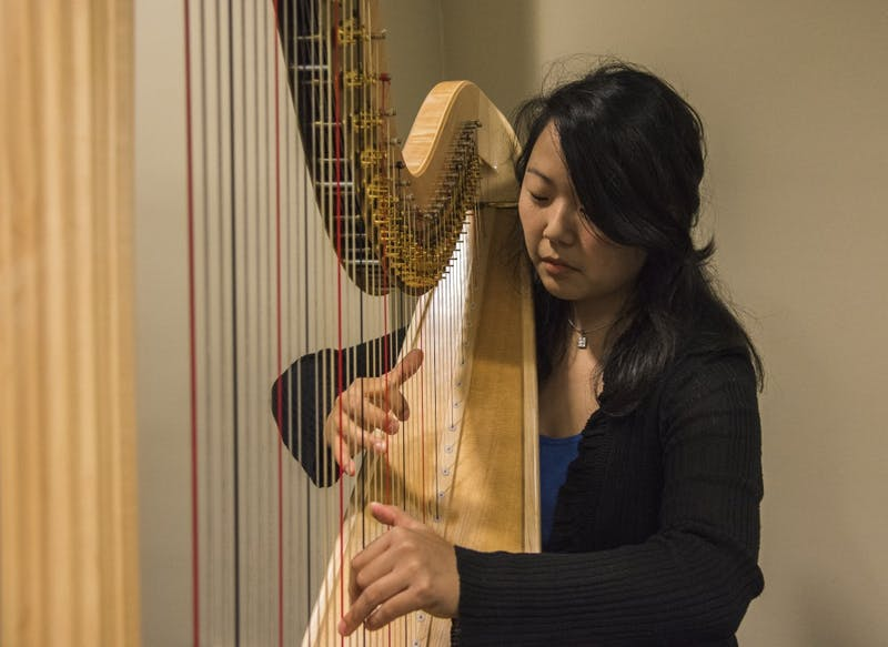 Annie King, a graduate assistant, has played the harp for twenty years. King teaches non-harp majors how to play the harp.