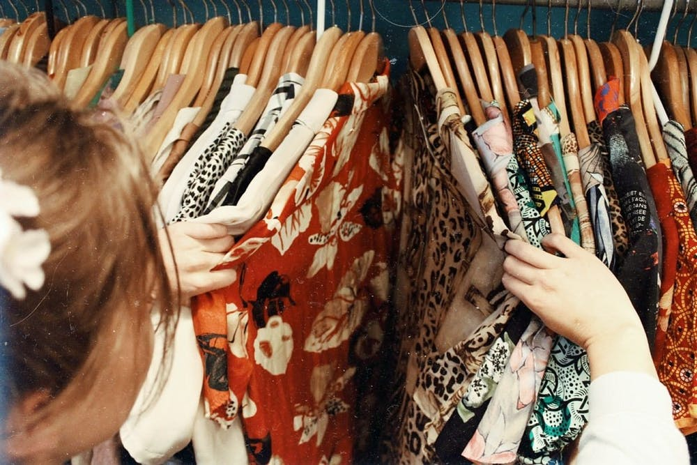 <p>Thrift shopping at local stores like Attic Window can help save money on clothes. <strong>Photo Courtesy, Unsplash</strong></p>
