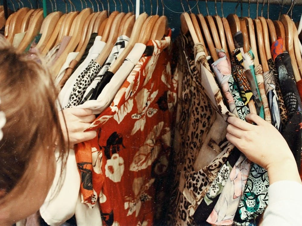 Thrift shopping at local stores like Attic Window can help save money on clothes. Photo Courtesy, Unsplash
