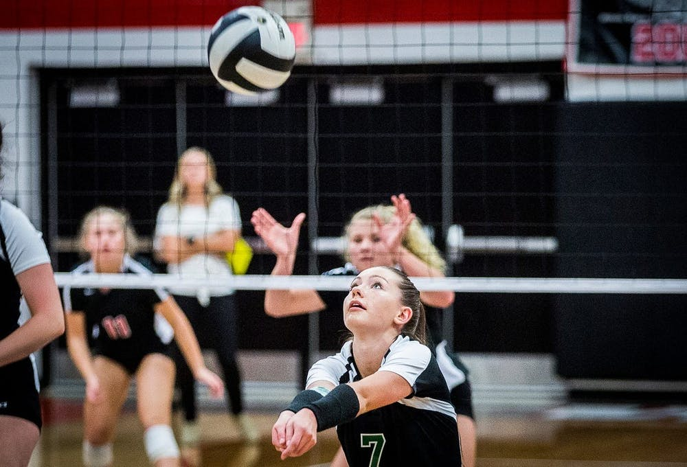 <p>Former Yorktown volleyball player Kate Vinson passes the ball in a game. Yorktown head coach Stephanie Bloom played at Ball State from 2001-04. <strong>Yorktown High School Athletics, Photo Provided </strong></p>