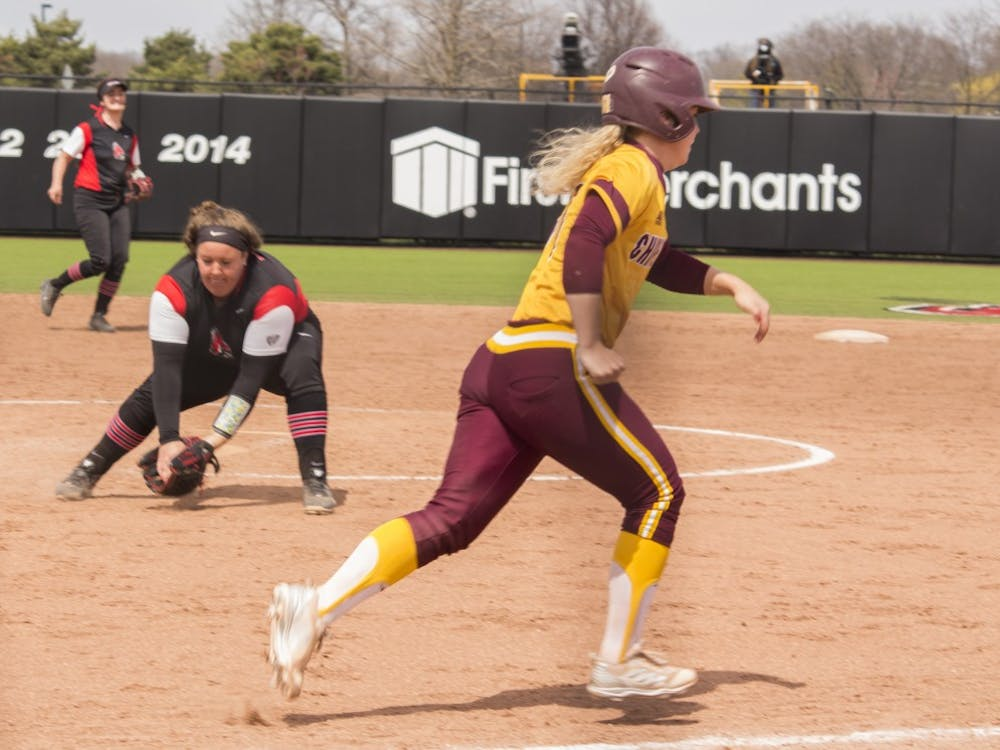 Ball State sophomore Alyssa Rothwell, left, catches a ground ball while Central Michigan player Madison Kalina runs to first base during the first game against the Chippewas April 21 at the softball field at First Merchant's Ballpark Complex. Kalina was called out. Briana Hale, DN