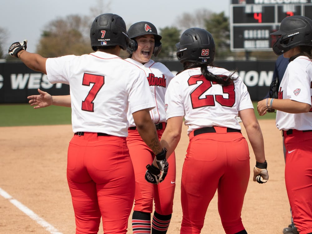 Ball State Cardinals cheer on graduate student infielder/outfielder Gabby Magnifico (second from left) after she hit a home run on April 23, 2021, at the Softball Field at First Merchants Ballpark Complex. The Cardinals won 4-2 against the Bobcats. Madelyn Guinn, DN