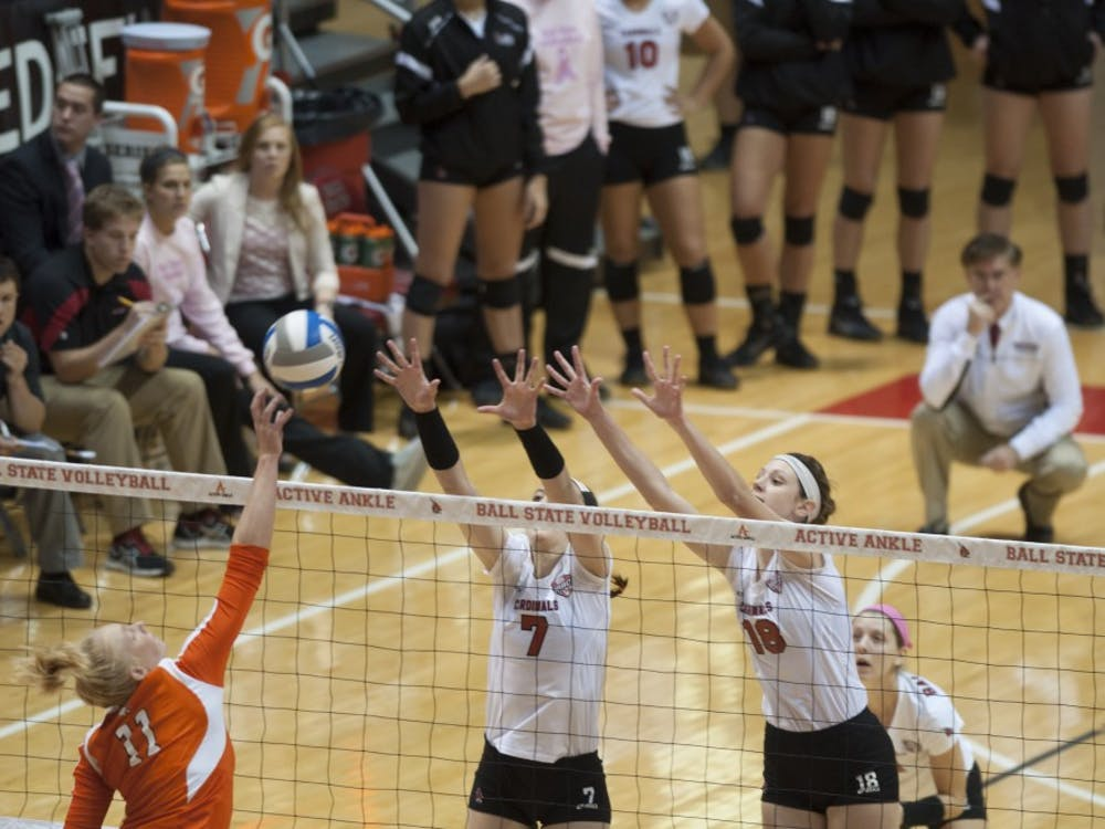 Senior opposite hitter Lauren Grant and sophomore middle hitter Hayley Benson jump up to block a hit against Bowling Green State University on Oct. 25 at Worthen Arena. Ball State lost the match 3-1. DN PHOTO MATT McKINNEY