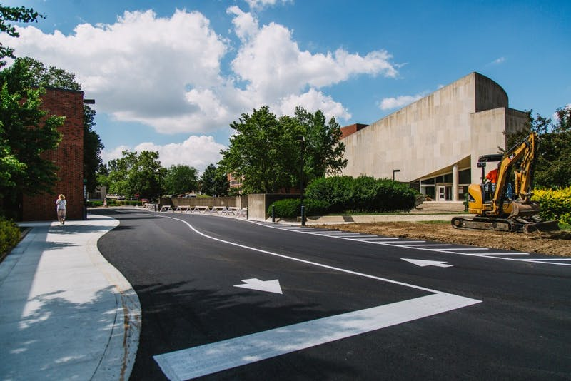 The road behind the parking garage and Pruis Hall has been complete. It was one of the temporary sidewalk closings occurring on campus. Reagan Allen // DN
