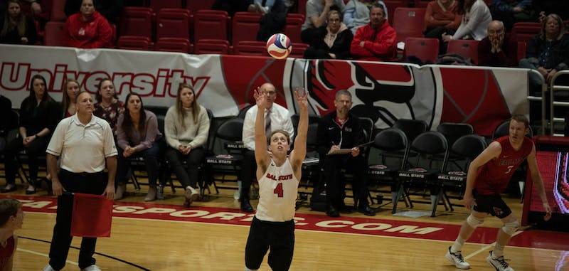 Senior libero Nick LaVanchy setting the ball for his team Feb. 15, 2020, at John E. Worthen Arena. The Cardinals lost 1-3 to the Flyers. Joshua Smith, DN