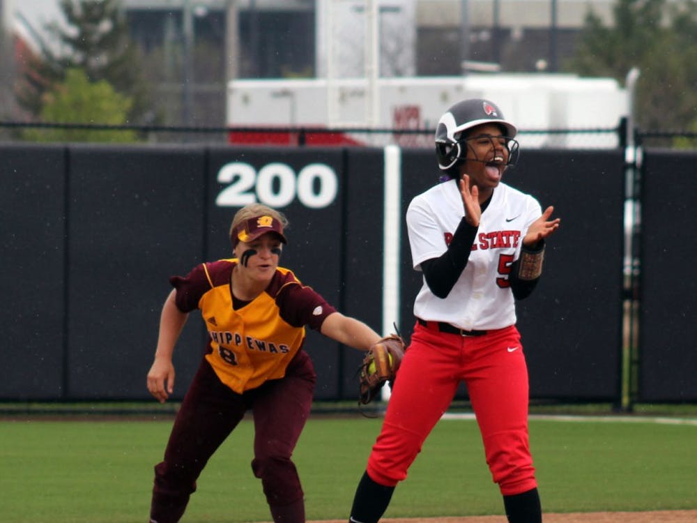 Freshman infielder Aeshia Miles attempts to rally her team as her opponent attempts to tag her out in the game against Central Michigan on Friday, April 22, 2016 at the Varsity Softball Complex. DN PHOTO ALLYE CLAYTON