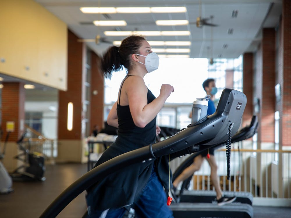Junior theater major Emma Grow runs on the treadmill Feb. 22, 2021, at the Jo Ann Gora Student Recreation and Wellness Center. While social distancing will not be observed as strictly as in the 2020-21 school year, people will still be required to wear masks on campus in indoor facilities regardless of their vaccination status. Jaden Whiteman, DN File