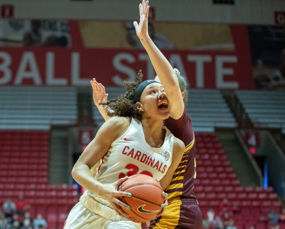 <p>Junior forward Oshlynn Brown gets hit in the face while going in the paint Feb. 29, 2020, at John E. Worthen Arena. Brown had 17 points for the Cardinals. <strong>Jacob Musselman, DN</strong></p>