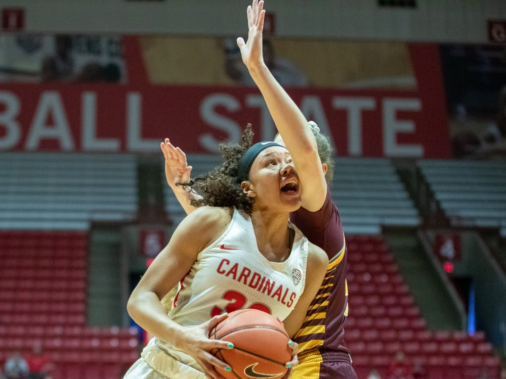 Junior forward Oshlynn Brown gets hit in the face while going in the paint Feb. 29, 2020, at John E. Worthen Arena. Brown had 17 points for the Cardinals. Jacob Musselman, DN