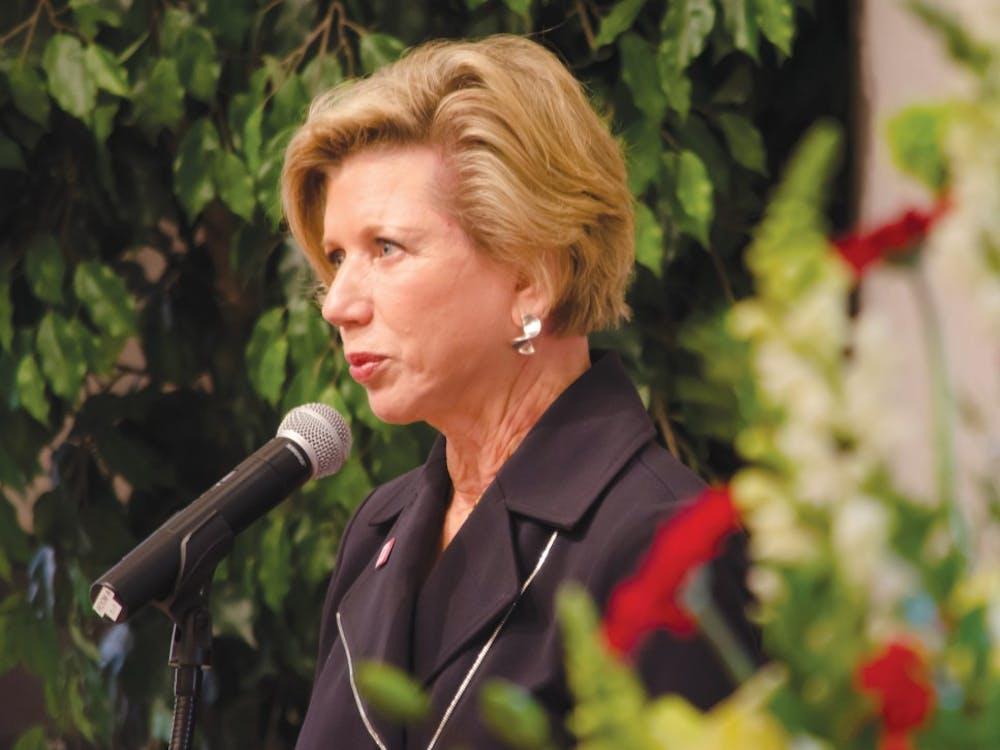 President Jo Ann Gora speaks at a memorial service on Sept. 30 at the Alumni Center. Gora announced her retirement for June 2014. DN FILE PHOTO COREY OHLENKAMP