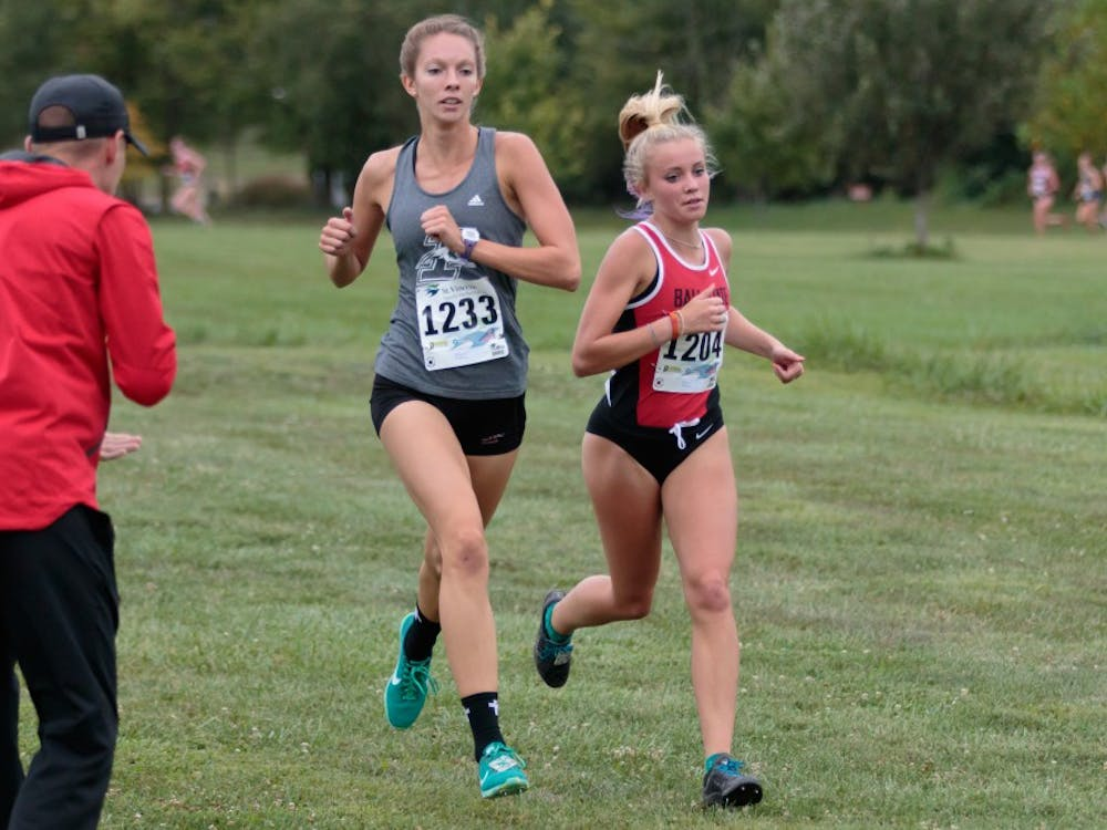 Runner Cayla Eckenroth fights for the lead during the Butler Twilight meet at Northview Church on Sept. 1, in Carmel, IN. Eckenroth finished second in the 5K with a time of 18:27.3. Kyle Crawford, DN File