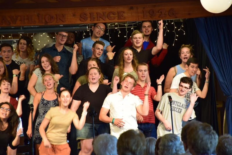 Casey Picillo, middle, performs in one of Fair Hills Tuesday night hootenanny's. The song and dance routine is put on by the entire staff of the Minnesota resort and is claimed to be one of the favorite activities by staff and guests alike. Casey Picillo // Photo Provided