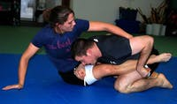 Ball State English professor Kathryn Gardiner attempts to take down an opponent during a training session. She finished her competitive cage fighting career with a record of 2-2. Debra Branscome, photo provided