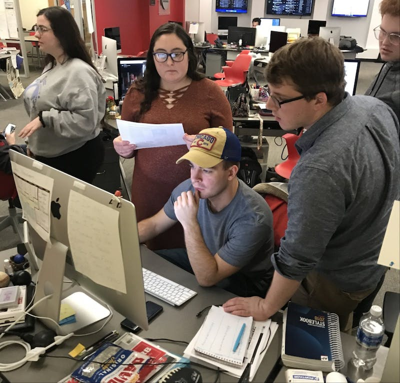 Daily News staff members create the newspaper while reporting on Ball State University's plan in response to COVID-19 March 11, 2020, in the Unified Media Lab. Lisa Renze-Rhodes, Photo Provided