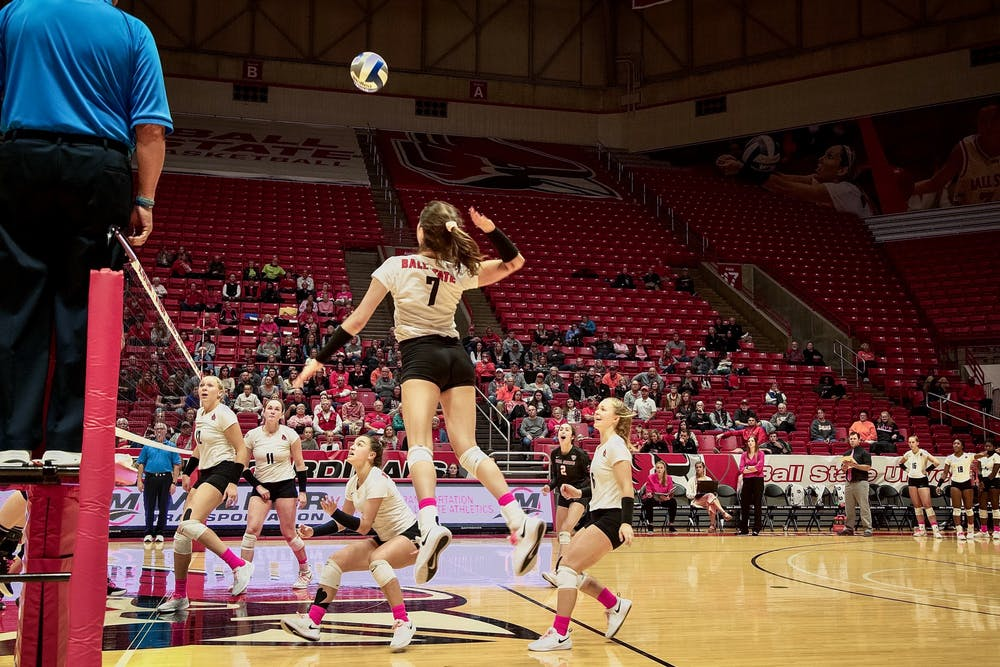 <p>Freshman outside hitter, Natalie Risi (7), gets airborne to spike the ball during the second game against Bowling Green State Falcons on October 26, 2019, at John E. Worthen Arena. The Falcons defeated the Cardinals 3-2. <strong>Omari Smith, DN</strong></p>