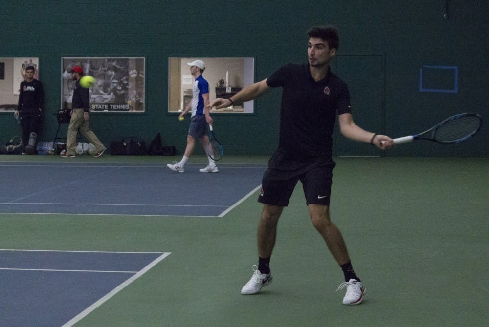 <p>Ball State men's tennis player Marko Guzina prepares to return the ball during a singles set against Eastern Illinois University on Jan. 20 at the Northwest YMCA of Muncie. Guzina won his set. <strong>Briana Hale, DN</strong></p>