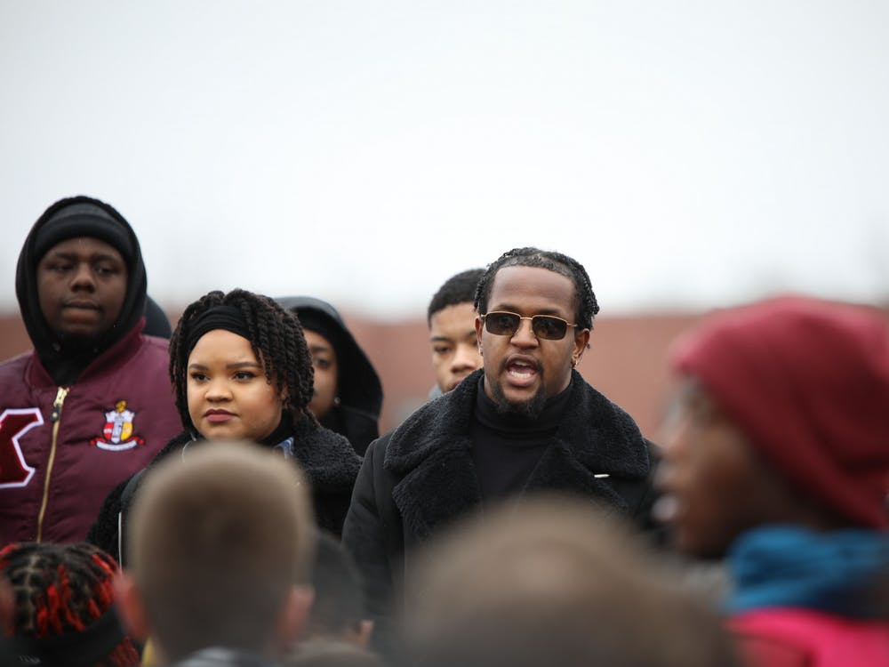 Kwesi Rogers speaks on stage at the walkout 11 a.m. Jan. 28. 2020, at University Green. Rogers questioned on stage why he and other members of the Black community have to demand respect when they deserve it. Demi Lawrence, DN