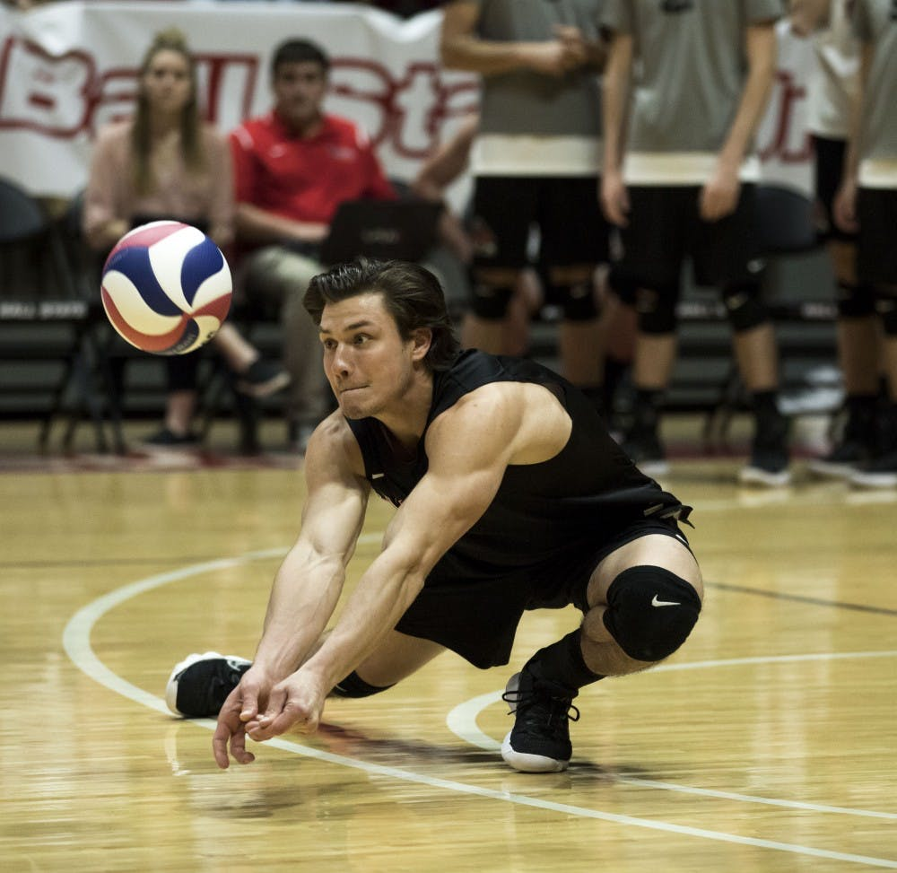 <p>Junior libero Adam Wessel passes a serve during the match against Fort Wayne on March 17 in Worthen Arena. Wessel assisted the Cardinal's 3-0 win by having a total of 10 digs throughout the match. <strong>Rachel Ellis, DN&nbsp;</strong></p>