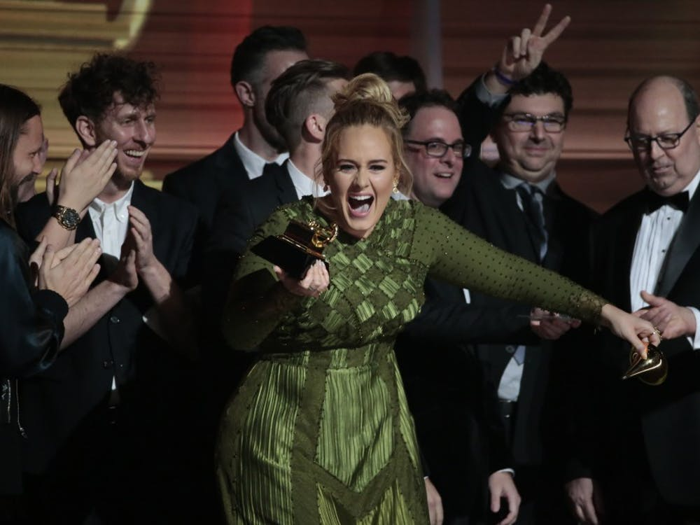 Adele on stage after winning Album of the Year for ''25'' during the 59th Annual Grammy Awards at Staples Center in Los Angeles on Sunday, Feb. 12, 2017. (Robert Gauthier/Los Angeles Times/TNS)