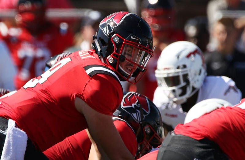 Ball State redshirt junior quarterback Drew Plitt looks down the offensive line during the Cardinals' game against Florida Atlantic Saturday, Sept. 14, 2019, at Scheumann Stadium. Plitt had 303 passing yards. Paige Grider, DN
