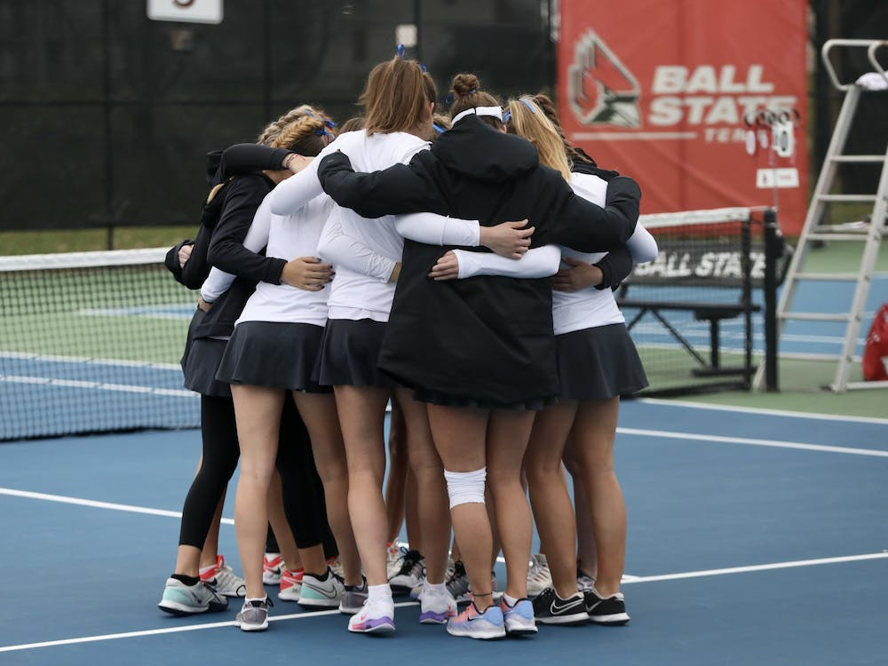 The Ball State Women's Tennis team huddles before a match March 26, 2021, in the Cardinal Creek Tennis Center. The Cardinals won 4-3 against the Falcons. Rylan Capper, DN