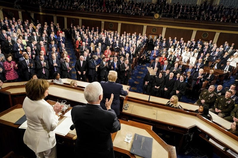 President Donald Trump delivers his State of the Union address to a joint session of Congress on Capitol Hill in Washington, Tuesday, Feb. 4, 2020, as House Speaker Nancy Pelosi of Calif., left, and Vice President Mike Pence watch. (Doug Mills/The New York Times via AP, Pool)