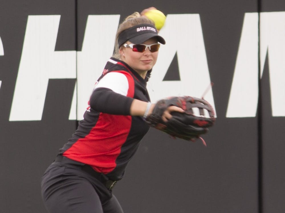 Ball State junior Haley Dominique throws the ball during the first game against Central Michigan April 21, 2018, at the softball field at First Merchant's Ballpark Complex. Briana Hale, DN