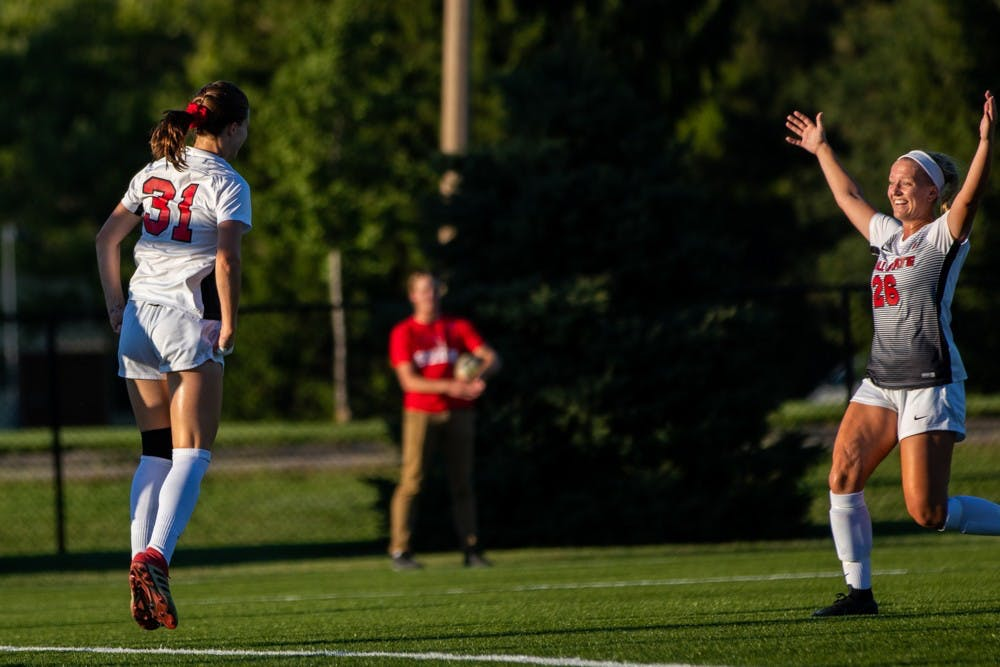 Tatiana Mason and Jenna Dombrowski celebrate after Mason scores a goal putting the Cardinals in the lead against the University of Nebraska-Omaha Friday, Sept. 14, 2018 at Briner Sports Complex. Ball State went on to defeat Omaha 3 to 1 with all goals being scored in the second half of the game. Eric Pritchett,DN