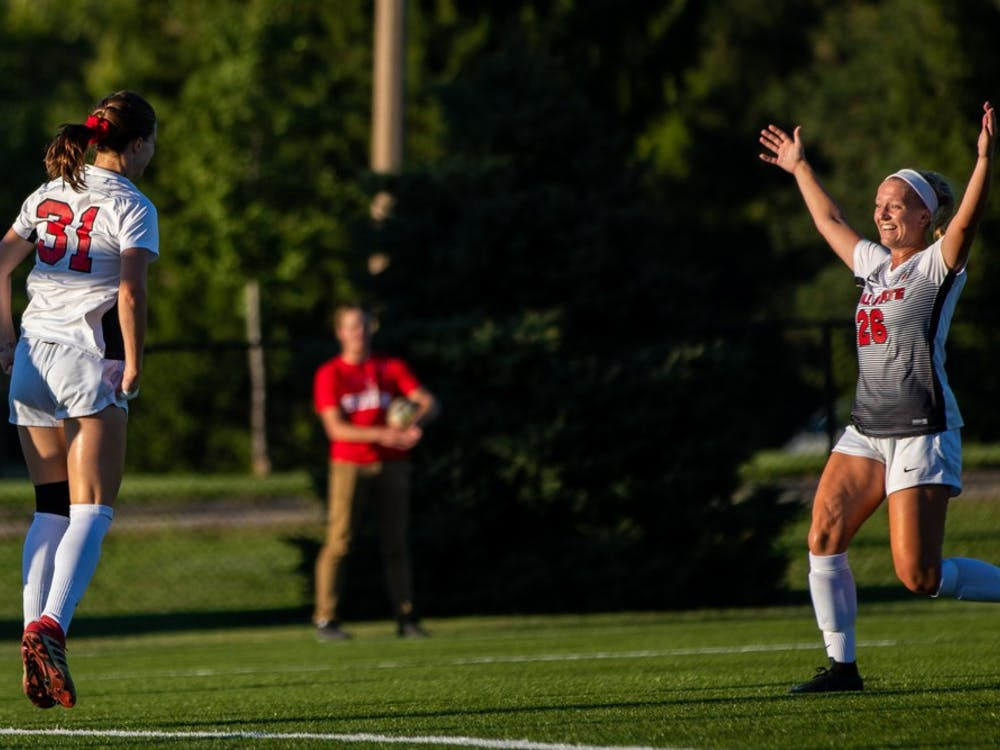 Tatiana Mason and Jenna Dombrowski celebrate after Mason scores a goal, putting the Cardinals in the lead against the University of Nebraska-Omaha Friday, Sept. 14, 2018, at Briner Sports Complex. Ball State went on to defeat Omaha 3-1 with all goals being scored in the second half of the game. Eric Pritchett, DN File