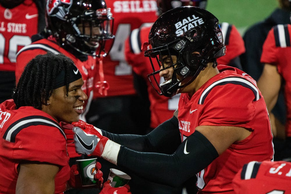 <p>Ball State junior wide receiver Yo&#x27;Heinz Tyler talks with a teammate after scoring a touchdown Nov. 18, 2020, at Scheumann Stadium. Ball State won 31-25 against the Huskies. <strong>Jaden Whiteman, DN</strong></p>