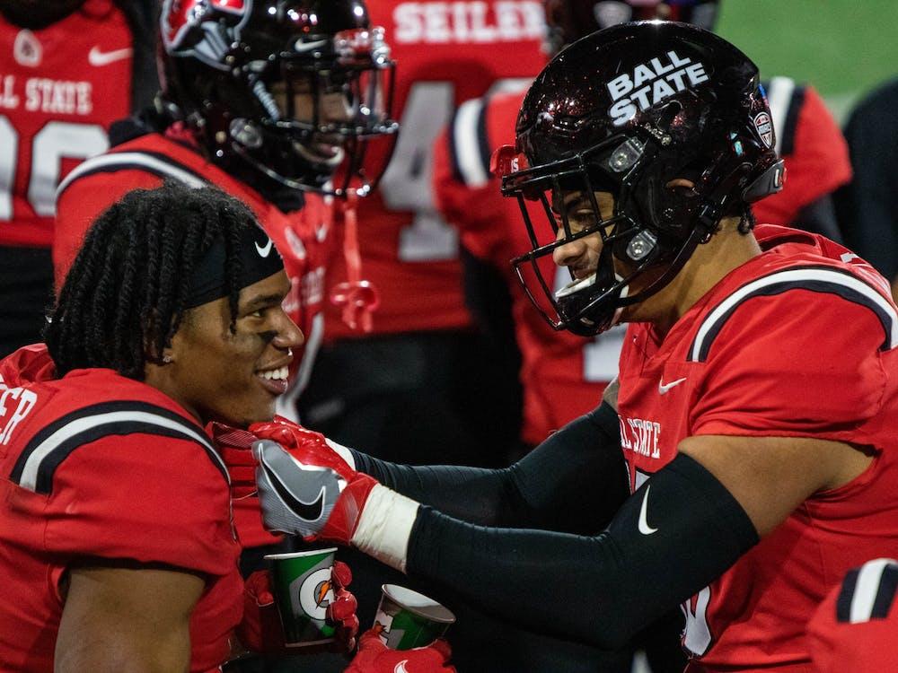 Ball State junior wide receiver Yo'Heinz Tyler talks with a teammate after scoring a touchdown Nov. 18, 2020, at Scheumann Stadium. Ball State won 31-25 against the Huskies. Jaden Whiteman, DN