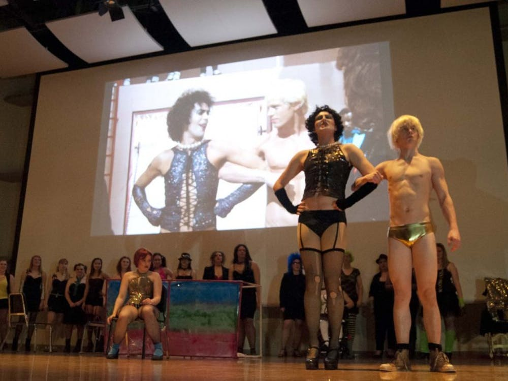 Students enact the Rocky Horror Picture Show last year at an annual event in Pruis Hall. Students bring out wacky traditions and customs that are a large part of the experience. DN FILE PHOTO DYLAN BUELL