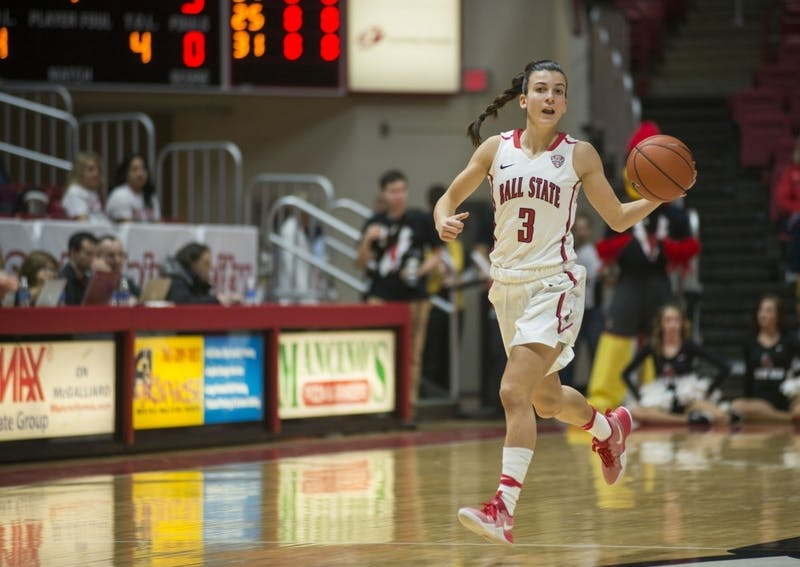Sophomore guard Carmen Grande dribbles down court at the game against Northern Illinois University on Jan. 28 in Worthen Arena. Grande came to Ball State from Spain to play basketball and is third in the nation with 7.8 assists per game. Breanna Daugherty // DN