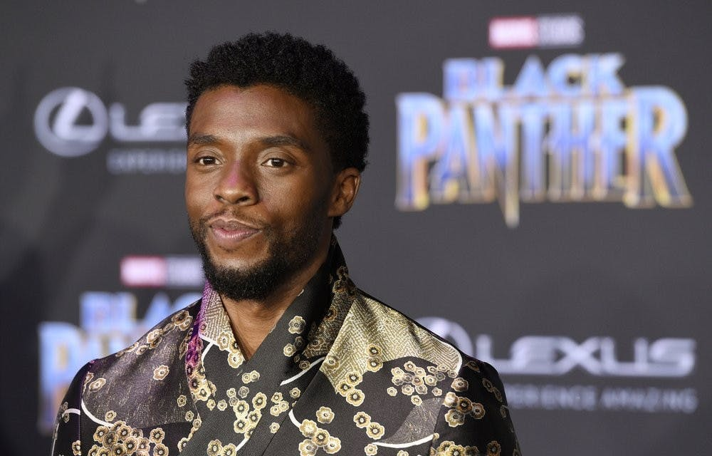 "FILE - In this Jan. 29, 2018 file photo, Chadwick Boseman, a cast member in ""Black Panther,"" poses at the premiere of the film in Los Angeles. Actor Chadwick Boseman, who played Black icons Jackie Robinson and James Brown before finding fame as the regal Black Panther in the Marvel cinematic universe, has died of cancer. His representative says Boseman died Friday, Aug. 28, 2020 in Los Angeles after a four-year battle with colon cancer. He was 43. (Photo by Chris Pizzello/Invision/AP, File)"