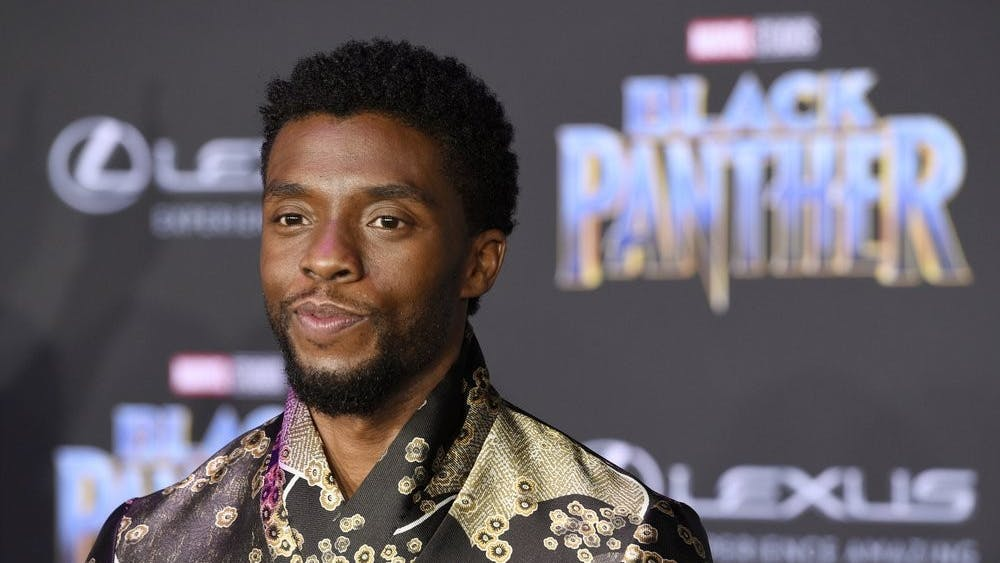 """FILE - In this Jan. 29, 2018 file photo, Chadwick Boseman, a cast member in """"Black Panther,"""" poses at the premiere of the film in Los Angeles. Actor Chadwick Boseman, who played Black icons Jackie Robinson and James Brown before finding fame as the regal Black Panther in the Marvel cinematic universe, has died of cancer. His representative says Boseman died Friday, Aug. 28, 2020 in Los Angeles after a four-year battle with colon cancer. He was 43. (Photo by Chris Pizzello/Invision/AP, File)"""