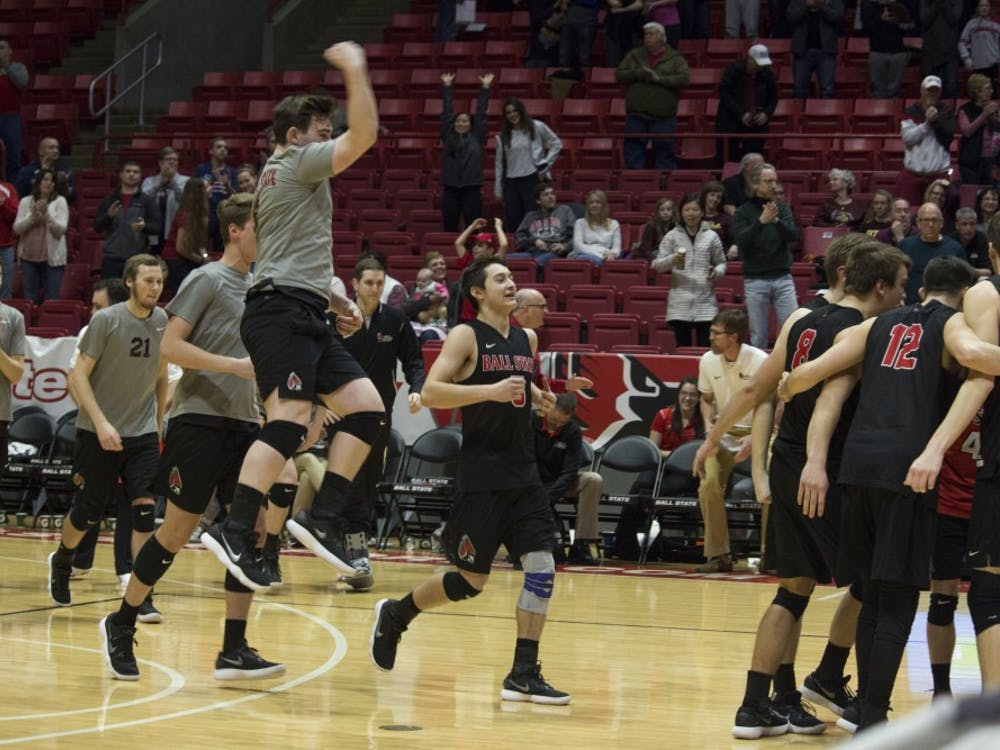 The Ball State men's volleyball team celebrates after winning the game against Loyola University on Feb. 17 at John E. Worthen Arena. Loyola had won eight straight games before being defeated by Ball State. Briana Hale, DN