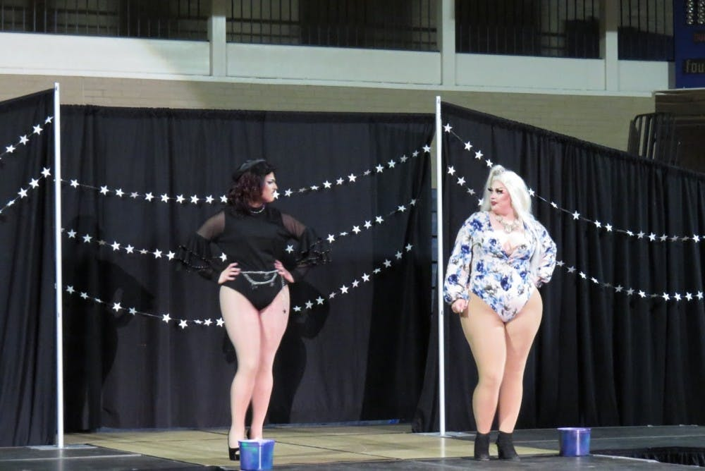 <p>Two performers interact on stage during Spectrum's Gaylactic Drag Show April 6, 2019, at Ball Gym. Money raised at the drag show will benefit the National Center of Transgender Equality. <strong>Chase Martin, DN</strong></p>
