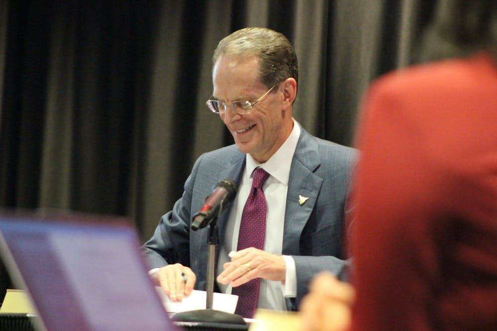 <p>In this Jan. 31, 2020, photo, President Geoffrey Mearns signs the documentation to extend his presidency at Ball State's Board of Trustees meeting. Ball State will begin to reopen campus and campus activities in three phases. <strong>Bailey Cline, DN&nbsp;</strong></p>